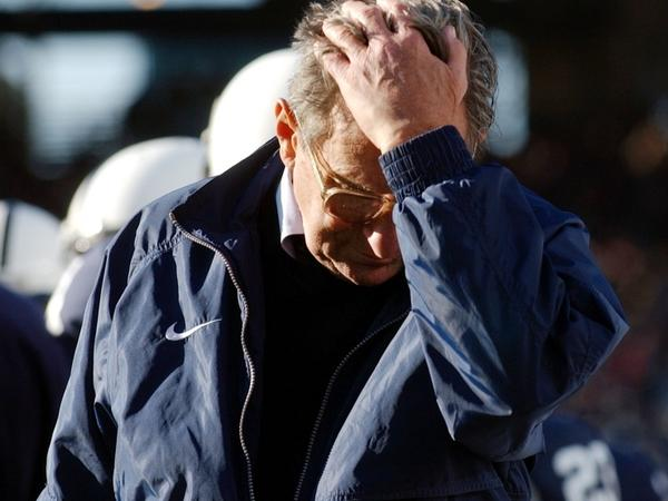 Penn State football coach Joe Paterno pauses on the sidelines during a game against Northwestern. Paterno's former assistant coach Jerry Sandusky has been accused of sexual abuse.