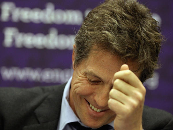 British actor Hugh Grant attends a fringe meeting during the Conservative Party Conference at Manchester Central on October 4, 2011.