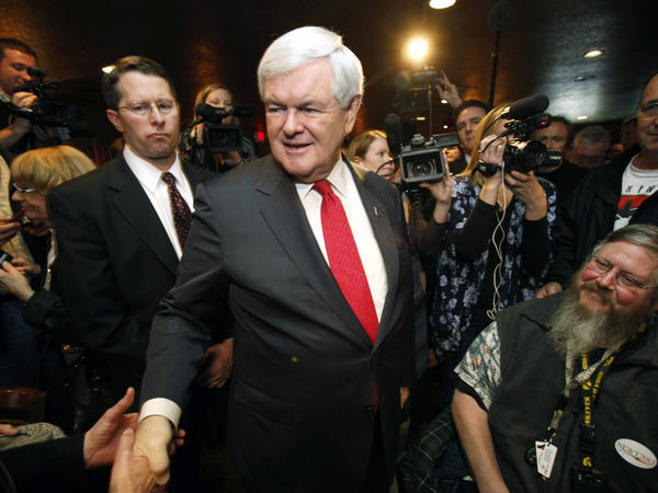Republican presidential candidate Newt Gingrich greets local residents after speaking at the Willow Ridge Golf Course on Dec. 15 in Fort Dodge, Iowa.