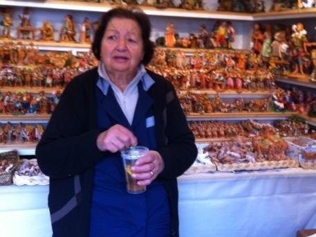 Anna Alferoni, 80, runs the oldest stall in Piazza Navona, site of Rome's most popular Christmas market. This year, she's having trouble selling even relatively inexpensive Nativity scene figurines.