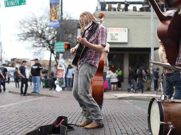 A musician performs at the Bat Bar during SXSW 2011 in Austin, Texas.