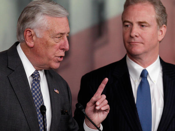 House Minority Whip Steny Hoyer answers reporters' questions about the House's inability to pass a payroll tax cut extension. At right is Democratic Rep. Chris Van Hollen of Maryland.