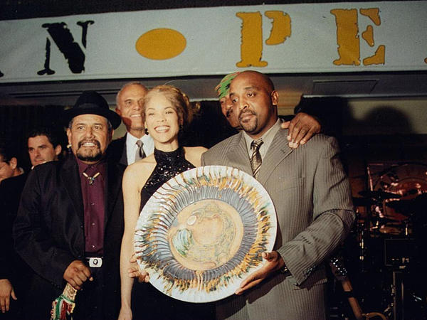 Rice celebrates a gang truce with Nana Alejandres and Bo Taylor, two chieftains who became friends. In the background: activist Harry Belafonte and former NFL great turned activist Jim Brown, whose Amer I Can Foundation works with gangs.