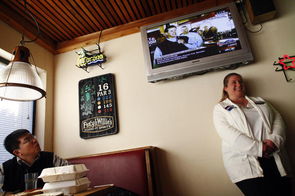 Republican presidential candidate Rick Santorum is seen on a TV screen at a restaurant in Florence, S.C., on Sunday.