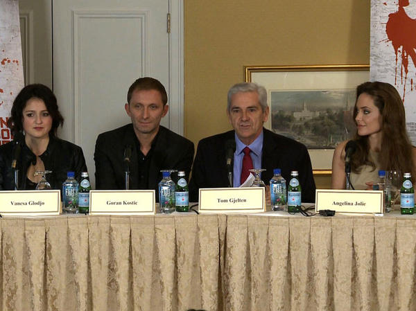 NPR's Tom Gjelten joined Angelina Jolie (right) on a panel about the film <em>In the Land of Blood and Money</em>. Also seen are Vanesa Glodjo (left) and Goran Kostic, who act in the film.