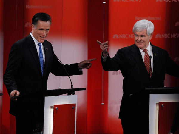 Former Massachusetts Gov. Mitt Romney and former House Speaker Newt Gingrich debate at the University of South Florida in Tampa on Monday.