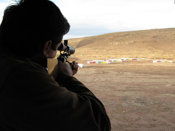 Alex LeBaron points his gun toward a target at a local shooting club. If Alex makes it into the federal Congress, his most passionate issue will be changing Mexico's gun laws.