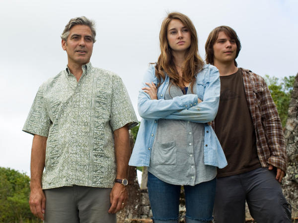 George Clooney as Matt King, Shailene Woodley as Alexandra King, and Nick Krause as Sid in <em>The Descendants.</em>