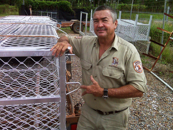 "Crocodile ranger Tom Nichols stands beside the crocodile traps used in Darwin Harbour. Nichols' left hand was mangled by an irate ""salty"" nine years ago."