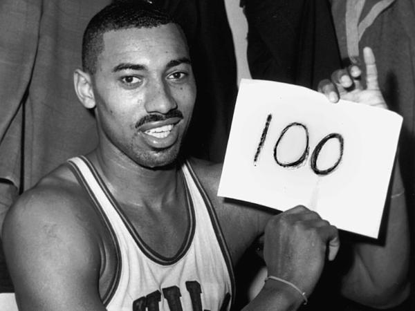 Wilt Chamberlain of the Philadelphia Warriors poses in the dressing room after he scored 100 points in a game against the New York Knickerbockers on March 2, 1962.