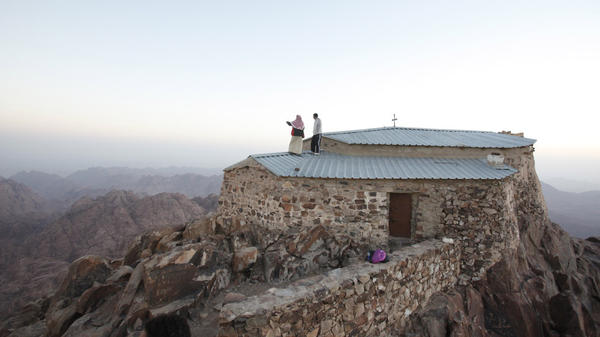 A Bedouin man takes a visitor on a tour of Mount Catherine in South Sinai. Bedouin tribesmen in the region say they have been kidnapping Western tourists to pressure the Egyptian government to meet their basic needs and release jailed Bedouins.