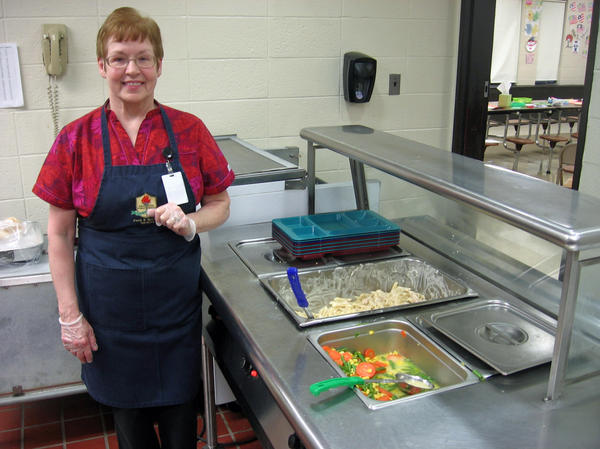 Kathleen Fiengo has worked in school cafeterias for 25 years, but only in the past year did she start cooking supper for kids at Nathan Hale Elementary in Manchester, Conn.