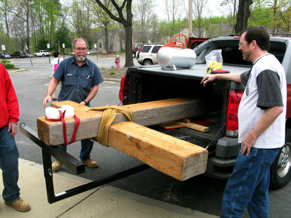 Wayne Marsh (right) and Loren Nystrom (left) help put the Church of the Apostles' cross into storage. The church will be shuttered and, eventually, sold by the Episcopal Diocese.