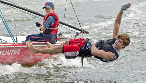 In this publicity image released by Universal Pictures, Charlie Tahan, left, and Zac Efron go sailing in <em>Charlie St. Cloud</em>.
