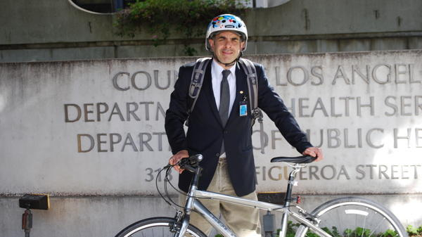 Dr. Mitch Katz rides his bike to work, defying the commuting norm in Los Angeles.