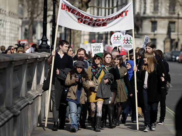 Demonstrators march from Downing Street to the Houses of Parliament to protest against austerity measures as the Chancellor of the Exchequer George Osborne prepares to leave 11 Downing Street on Budget Day March 21, 2012 in London, England. Great Britain has re-entered a recession.