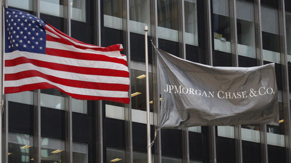 The U.S. and JPMorgan Chase flags wave outside its headquarters in New York on Friday.