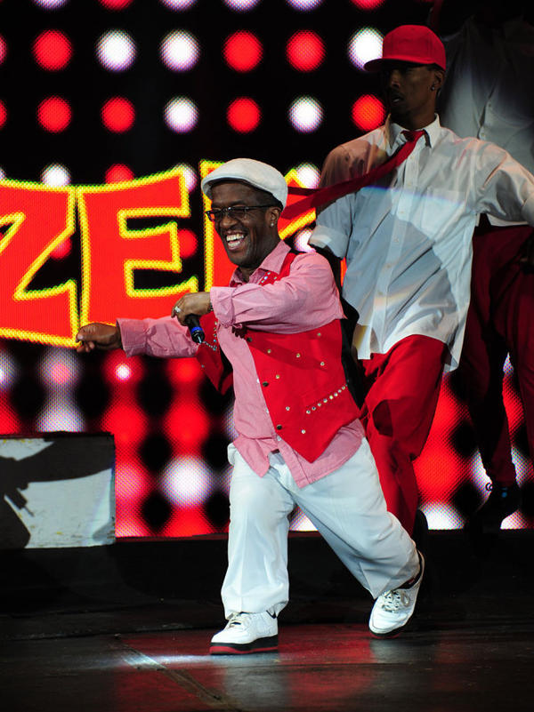 "Zanda ""Zeke"" Charles began as UniverSoul's ringmaster sidekick 18 years ago. Today, he co-hosts the show, and, when not in the ring, he roams the audience signing autographs and giving out hugs."