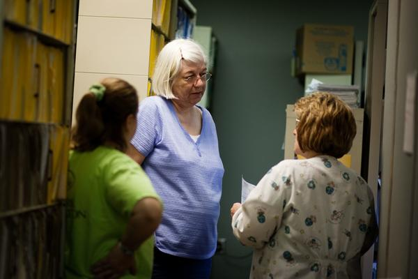 Cornerstone nurse Kay Allen (center) talks with her co-workers. Some staffers stopped coming into the clinic because of the fumes.
