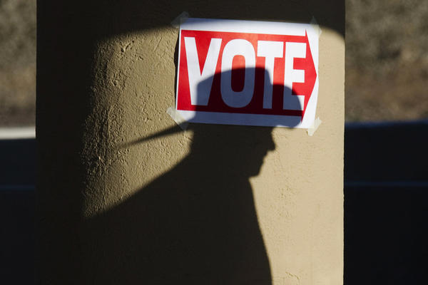 A Republican voter goes to the polls at the Wickenburg Community Center in Wickenburg, Ariz., on Tuesday.