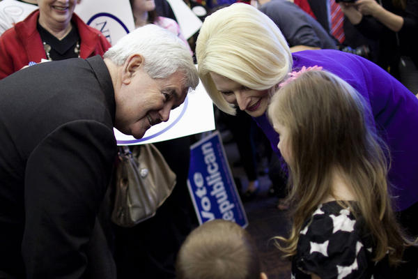 "Gingrich and wife Callista meet Kaylan Cape, 5, in Dalton. The former Georgia congressman said Tuesday that he ""unequivocally"" has to win there."