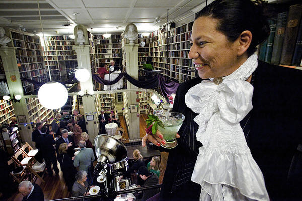 Chilean artist Magaly Ponce looks out from the mezzanine at the Oscar Wilde party in February.