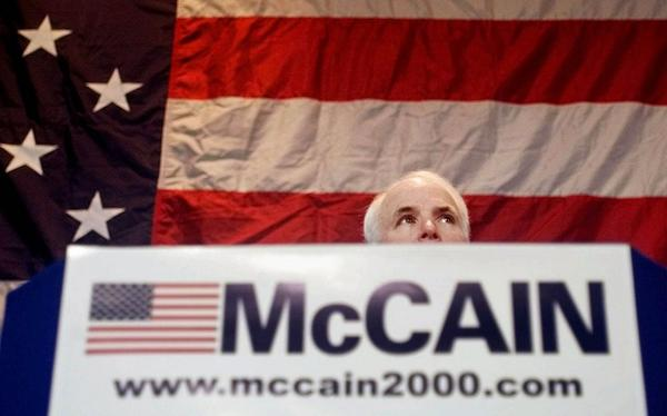 Tactics used against Sen. John McCain, of Ariz. in the 2000 GOP primary included aggressive 'push polling' and unsubstantiated allegations that he had an illegitimate child. McCain listens to a question during a town hall meeting in Spartanburg, S.C., Thursday, Feb. 10, 2000.