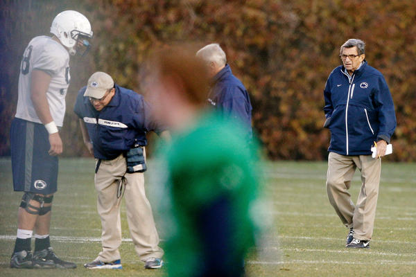 Usually attired in thick, smoky-lens glasses, rolled up khakis, jet-black sneakers and a blue windbreaker, Paterno was easy to spot on the sidelines.