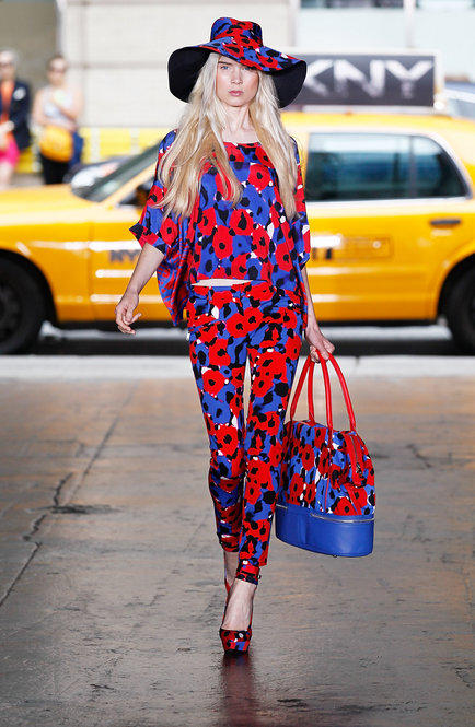 DKNY models strutted in front of New York taxis, which played up the vivid red-and-blue floral that was painted on everything from head to toe.