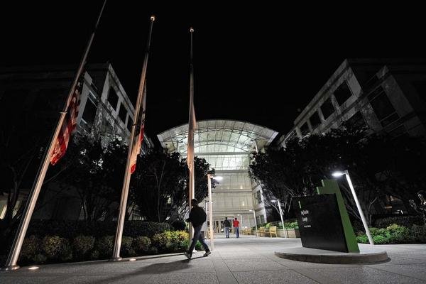 Flags fly at half staff after the death of Steve Jobs at the Apple headquarters in Cupertino, Calif.