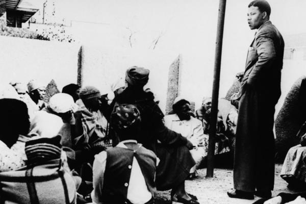 Mandela talks to a group of women demonstrating against the pass laws, which required black South Africans to carry identity documents, in 1959.