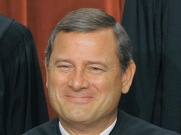 Chief Justice John Roberts poses with Supreme Court justices during the official photo on September 29, 2009 at the Supreme Court in Washington, D.C. Roberts joined with the court's liberals Thursday to uphold the Affordable Care Act.