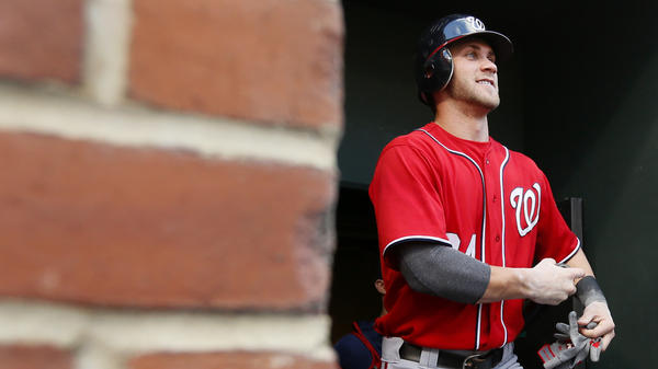 Washington Nationals' Bryce Harper walks out of the clubhouse before an interleague baseball game in Baltimore.