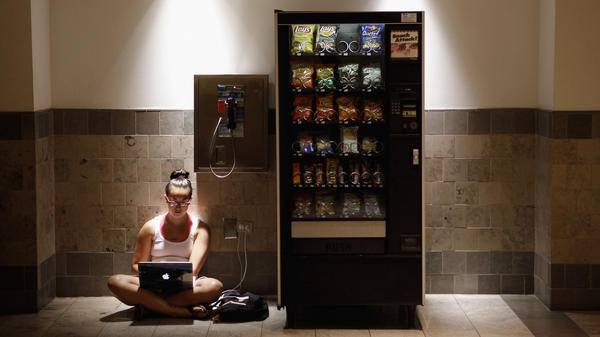 Katie Kiang sits by an electrical outlet and a quiet spot to study  inside the air-conditioned Westfield Montgomery Mall in Bethesda, Md., on Monday.