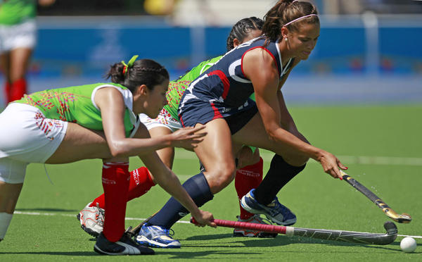 Paige Selenski (right) of the United States fights for the ball against two Mexican opponents in a women's field hockey match at last October's Pan American Games in Mexico.