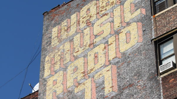 A mural advertising a radio station WABC in New York.