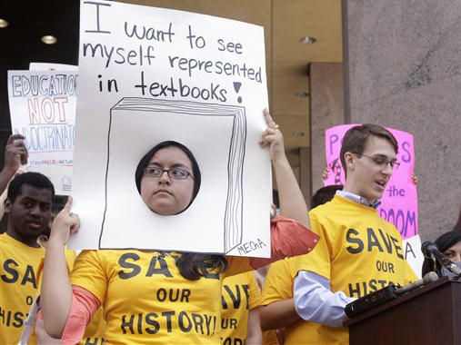 Diana Gomez and Garrett Mize rally before a state Board of Education meeting in Austin, Texas, in 2010.