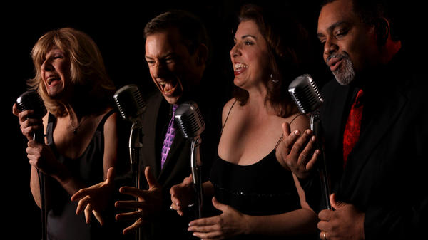The Uptown Vocal Jazz Quartet, left to right: Ginny Carr, alto; Robert McBride, tenor; Holly Shockey, soprano; and Andre Enceneat, bass. The group's new album, <em>Hustlin' for a Gig</em>, came out in May.