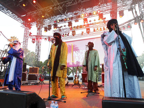 "A Tuareg band from Mali, Tinariwen, performs in Nice, France, in July. The band has developed an international reputation and won a Grammy this year. <a href=""http://www.npr.org/event/music/144431409/tinariwen-tiny-desk-concert"">See them perform at NPR headquarters.</a><strong></strong>"