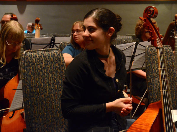 Zoe Weiss, a professional viol player from Boston, checks out the crowd before a performance of Sarah Mead's <em>The Ultimate Fantasy: Ralph Vaughan Williams' Fantasia on a Theme by Thomas Tallis</em>.