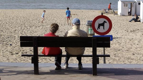 People enjoy a sunny day on the beach in Knokke, on Belgium's North Sea coast, in  April 2011. This summer, the weather hasn't been as nice — and resort owners and officials are feeling litigious over a pessimistic weather forecast.