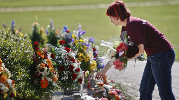A visitor lays flowers on the Virginia Tech campus in Blacksburg, Va., on April 16, five years after a lone gunman killed 32 people. Many colleges formed threat assessment teams in the aftermath of the Virginia massacre.