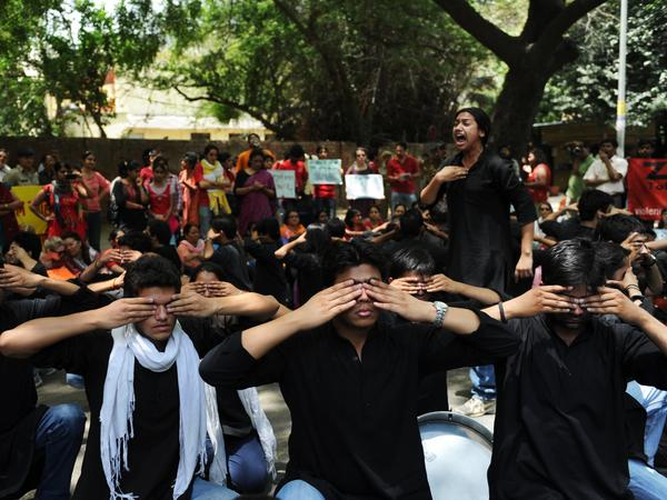 Protesters take part in a street play during a protest against growing cases of sexual abuse in New Delhi on May 5. The protesters urged  police to protect women from abusers and stop blaming victims for attacks.