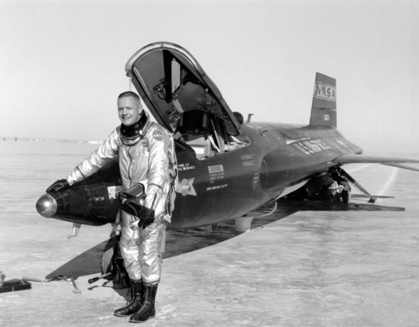 """Neil Armstrong stands next to his <a href=""""http://www.nasa.gov/centers/dryden/news/FactSheets/FS-052-DFRC.html"""">X-15 rocket plane</a> at Edwards Air Force Base in California."""