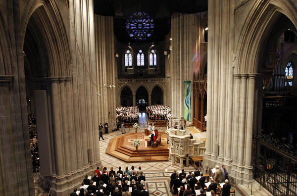 Members of the congregation stand at the Washington National Cathedral in Washington during the national memorial service for the first man to walk on the moon, Neil Armstrong.