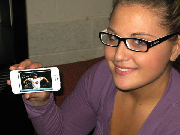 Sarah Wagner shows off an Egraph of Kerry Wood, her favorite Cubs player.