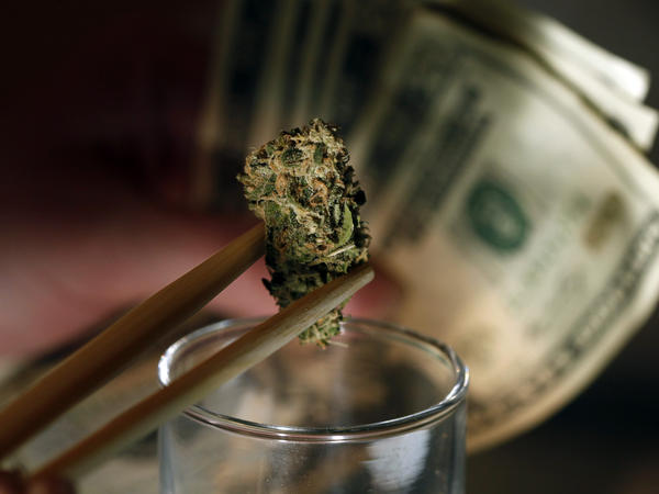 A marijuana bud at a marijuana dispensary in Denver. Colorado, Oregon and Washington could become the first to legalize marijuana this fall.