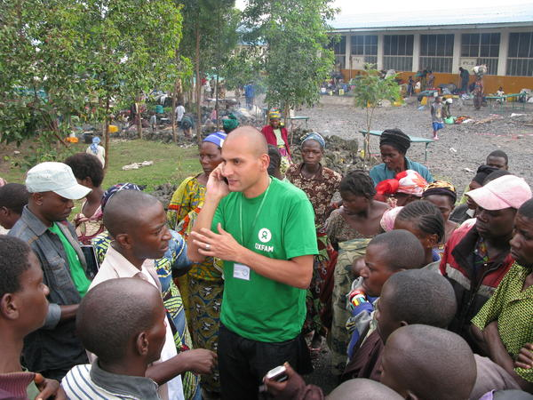 Tariq Riebl, Oxfam humanitarian coordinator in Goma, Democratic Republic of Congo, meets refugees at the Don Bosco Catholic School, where thousands of displaced persons are setting up camp.