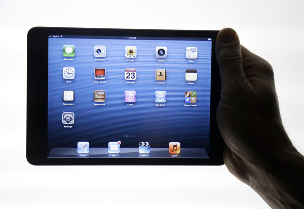 The iPad Mini is shown in San Jose, Calif., in October. Apple has priced its new, smaller iPad starting at $329, well above the competition.