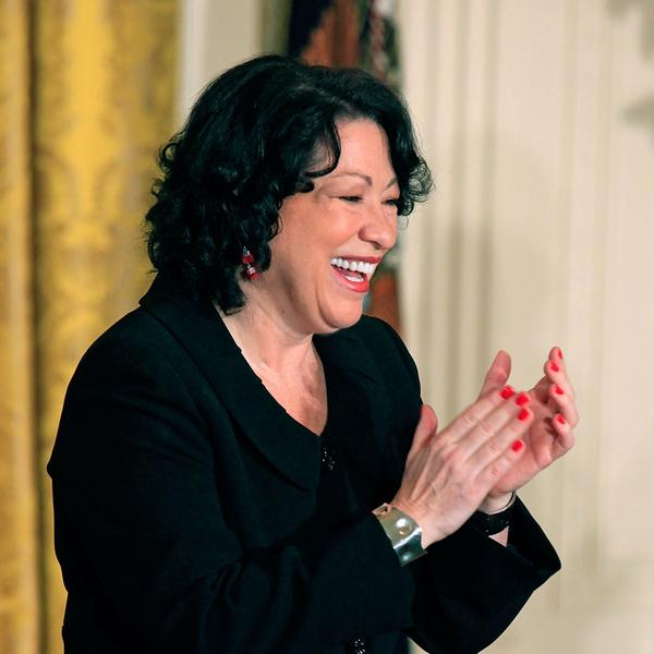 Supreme Court Associate Justice Sonia Sotomayor applauds during a reception in her honor at the White House.
